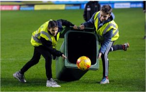 Binning it! Cherwell School students at the Kassam Stadium.